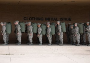 Trainees with their initial clothing issue on their backs.  (Photo: Robert Rubio/Air Force)